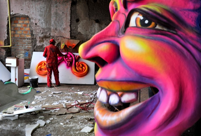"A craftsman gives the final touches to a float for the ""White Day"" parade, part of the Carnival of Blacks and Whites in Pasto, Colombia, on January 4. The Carnival of Blacks and Whites, annually celebrated on the eve of Three Kings Day, was declared by UNESCO as ""Intangible Cultural Heritage of Humanity."" (Luis Robayo/AFP/Getty Images)"
