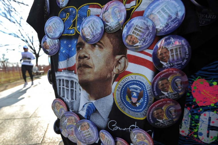 A woman jogs past a roadside souvenir stall displaying T-shirt with U.S. President Barack Obama's picture in Washington, DC, on January 5, 2013. Preparations are underway for Obama's second inauguration which will take place with a public ceremonial oath of office on January 21, 2013. (Jewel Samad/AFP/Getty Images)