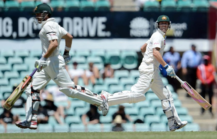 Australian cricket captain Michael Clarke (R) and teammate Ed Cowan run between the wickets on the fourth day of the third cricket Test match between Australia and Sri Lanka at the Sydney Cricket Ground on January 6, 2013. (Manan Vatsyayana/AFP/Getty Images)