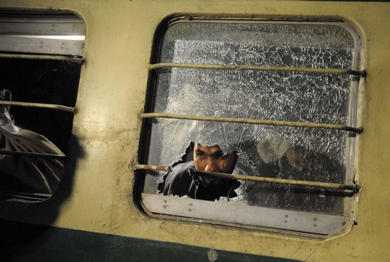 A Pakistani man looks through a broken mirror on the Jaffar Express train after an attack at a railway station in Quetta on early 6, 2012. Unidentified gunmen fired at a train in Pakistan's restive Baluchistan province, killing at least five people and seriously injuring 20 others. (Banaras Khan/AFP/Getty Images)