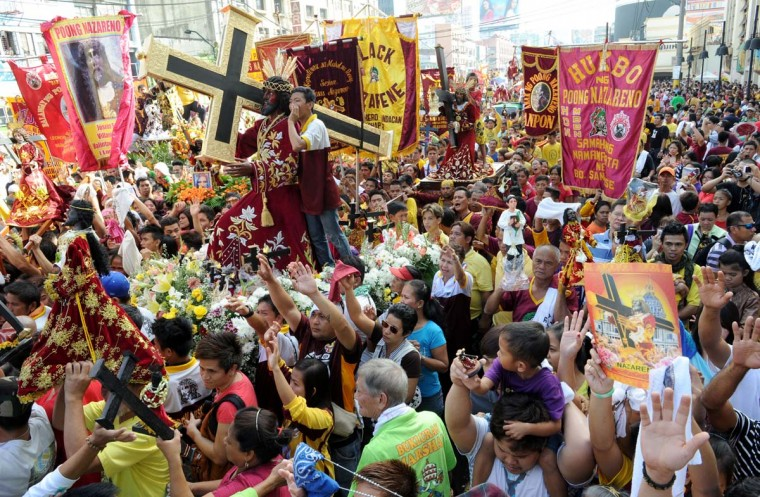 The replica of the religious icon the Black Nazarene is seen during a procession in Manila on January 7, 2013. Filipino pilgrims began arriving in the capital Manila for the annual religious festival that takes place on January 9. (Jay Directo/AFP/Getty Images)
