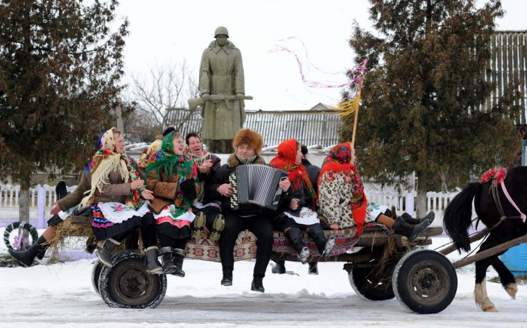 People sit on a horse-drawn cart as they attend Christmas celebrations in the town of Richev, some 290 km south from Minsk, on January 7, 2013. Orthodox Christians celebrate Christmas on January 7 in the Middle East, Russia and other Orthodox churches that use the old Julian calendar instead of the 17th-century Gregorian calendar adopted by Catholics, Protestants, Greek Orthodox and commonly used attendsin secular life around the world. (Viktor Drachev/AFP/Getty Images)