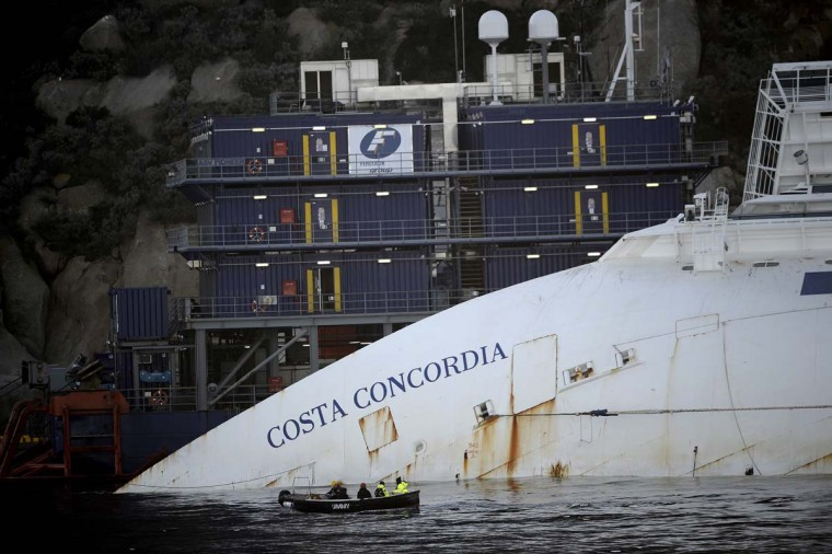 The Costa Concordia cruise ship lays aground near the port on January 7, 2013 on the Italian island of Giglio. The giant Italian cruise ship Costa Concordia ran aground near a Tuscan island and pitched leaving 32 people dead. (Filippo Monteforte/AFP/Getty Images)