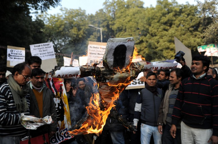 Indian students shout slogans as they burn an effigy of Indian spiritual guru Asharam during a protest in New Delhi. Asharam sparked a backlash Tuesday after saying a 23-year-old student could have averted a murderous gang-rape by begging for mercy from her attackers. The 71-year-old's remarks - the latest in a series of gaffes by public figures blaming women for the country's rape epidemic - drew a chorus of condemnation. (Sajjad Hussain/AFP/Getty Images)
