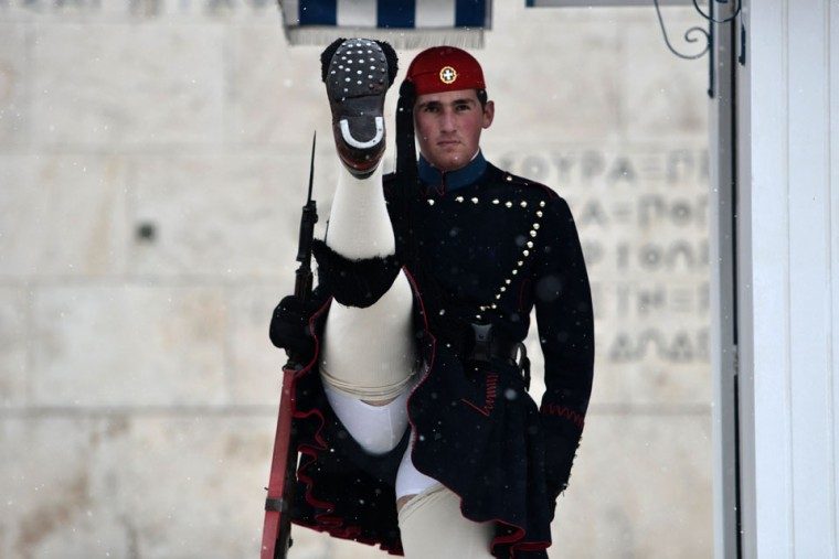A Greek Presidential Guard performs during a snowfall in Athens. (Aris Messinis/AFP/Getty Images)