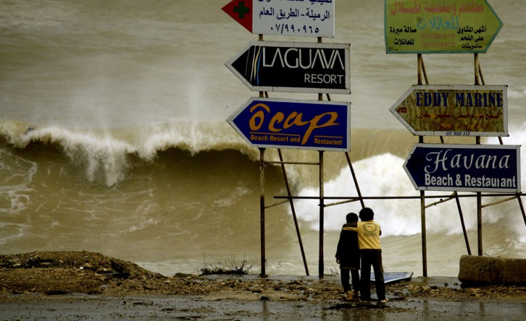 Children watch the waves on the shore of in the southern Lebanese town of Rmaileh, near Sidon. Stormy weather, including high winds and heavy rainfall, lashed the eastern Mediterranean coast, downing power lines and trees and causing several injuries in a number of countries. (Mahamoud Zayyat/AFP/Getty Images)