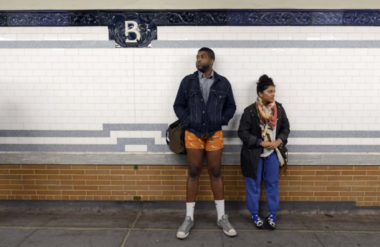 Some riders in the New York City subway in the underwear as the take part in the 2013 No Pants Subway Ride January 13, 2013. Started by Improv Everywhere, the goal is for riders to get on the subway train dressed in normal winter clothes (without pants) and keep a straight face. (Timothy A. Clary/AFP/Getty Images)