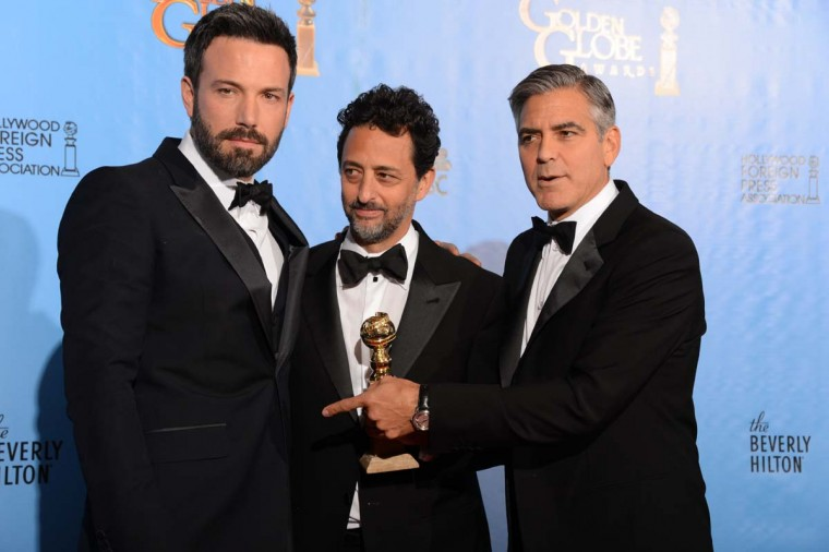 "Actor/director Ben Affleck (L) poses in the press room with producers Grant Heslov (C) and George Clooney with the award for best motion picture drama for ""Argo"" at the Golden Globes awards ceremony in Beverly Hills on January 13, 2013. (Robyn Beck/AFP/Getty Images)"
