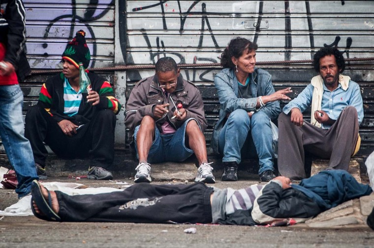 "Drug users flock together on a sidewalk in""Crackolandia"", a place where addicts gather to smoke crack, in downtown Sao Paulo Brazil on January 14, 2013. (Yasuyoshi Chiba/AFP/Getty Images)"