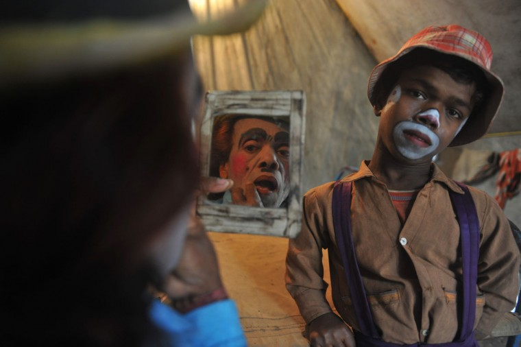 Indian clown Madhusudan Ghosh (L) ,63 applies makeup as her son Gourango Ghosh, 19 looks on in their tent at Kohinoor Circus in Siliguri on January 14, 2013. The Kohinoor Circus, inaugurated in 1988, is one of the most popular as it travels throughout India (Diptendu Dutta/AFP/Getty Images)