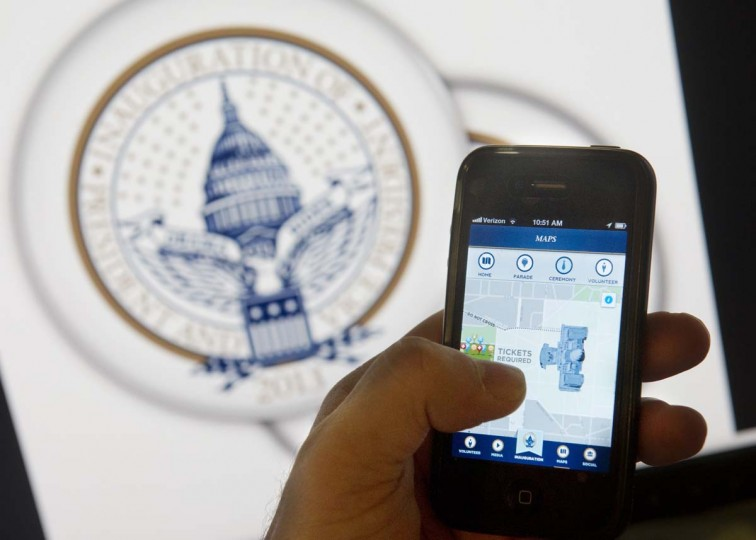 An iPhone app displays information about the second inauguration of US President Barack Obama in Washington, DC, on January 14, 2013. Organizers unveiled the first-ever smartphone app for a US presidential inauguration on Monday, allowing users to track Barack Obama's swearing in, sign up for events and check maps for the closest toilets. The Presidential Inaugural Committee's debut application for iPhone and Android users provides a front-row seat for people not in Washington on January 21, while offering tips to attendees on how to navigate the vast security apparatus set up for the big day. It will also provide live-stream video of Obama's swearing in for a second term, locations of viewer access points, schedules for events nationwide, and historical facts and figures about the 56 previous presidential inaugurations. (Saul Loeb/AFP/Getty Images)