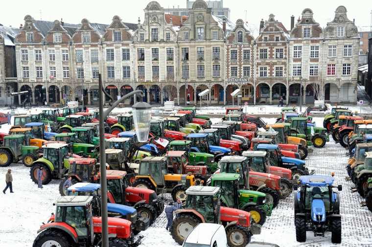 Farmers take part in a partial blockade with some hundred tractors, at the Grand'place in Arras, in northern France, during a demonstration called by farmers local union FDSEA, to denounce all kinds of pressure affecting their activities. (Philippe Huguen/AFP/Getty Images)