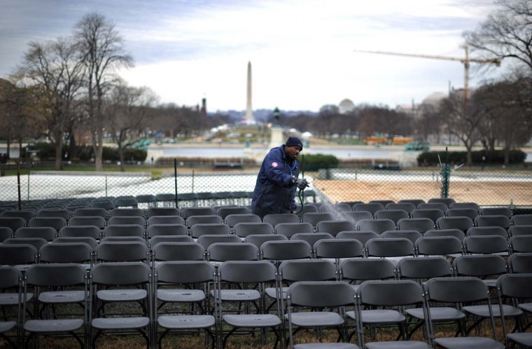 A worker washes chairs near the U.S. Capitol as preparations continue for the second inauguration of US President Barack Obama in Washington, DC, on January 17, 2013. Obama faces a near impossible task in his second inaugural address on January 21: uniting a nation in which the compromise that oils governing is crushed by deep political divides. Before a crowd of thousands and the eyes of the world on television and online, Obama will stand on the West Front of the US Capitol and swear to faithfully execute the office of president and defend the Constitution. (Jewel Samad/AFP/Getty Images)