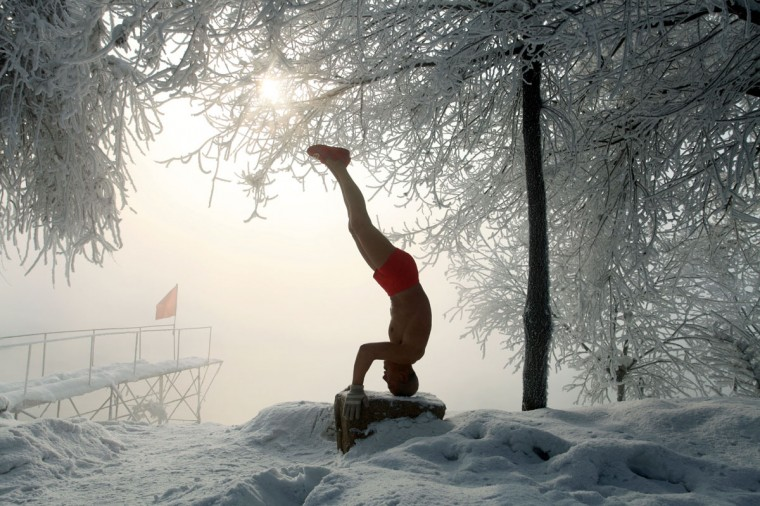 77-year-old retired teacher Gao Yinyu exercises in his underwear at a snow-covered bathing spot in Jilin, in northeastern China's Jilin province, in a temperature of minus 25 degrees Celsius on January 17, 2013. Gao has been exercising in only his underwear every morning for more than the past decade and has rarely caught a cold ever since retirement. (STR/AFP/Getty Images)