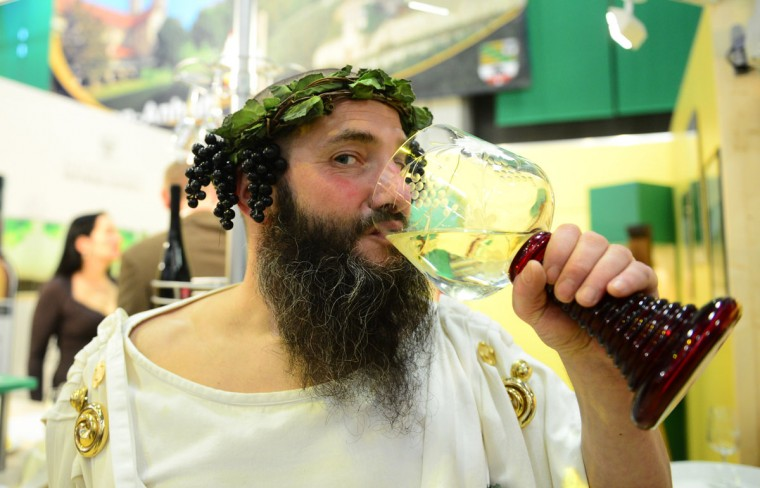 A disguised man drinks wine during the opening of the Gruene Woche (Green Week) Agricultural Fair in Berlin. (Johannes Eisele/AFP/Getty Images)