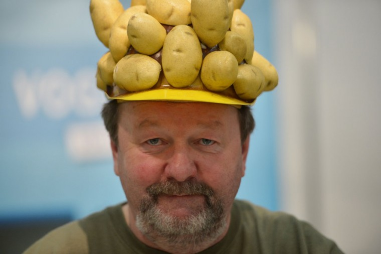 A man wears a potato hat during the opening of the Gruene Woche (Green Week) Agricultural Fair in Berlin. This year the official partner country of the fair is The Netherlands. (Johannes Eisele/AFP/Getty Images)