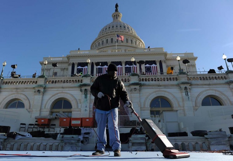 A worker vacuums a platform at the U.S. Capitol as preparations continue for the second inauguration of U.S. President Barack Obama in Washington on January 18, 2013. (Jewel Samad/AFP/Getty Images)