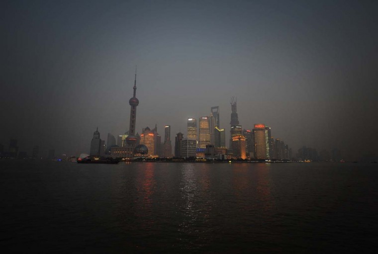 This photo taken on on January 18, 2013 shows the Pudong financial district in Shanghai. Several days of hazardous air quality across large swathes of northern China this week triggered an emergency response which saw schoolchildren kept indoors, factories closed and government cars parked. Experts are urging authorities to take firmer action to confront the consequences of China's rapid industrialisation -- and the spending habits of the middle classes created by its economic boom. (Mark Ralston/AFP/Getty Images)