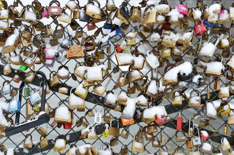 Padlocks (locks of love) are covered with snow on the Pont des Arts bridge on January 19, 2013 in Paris. (Miguel Medina/AFP/Getty Images)