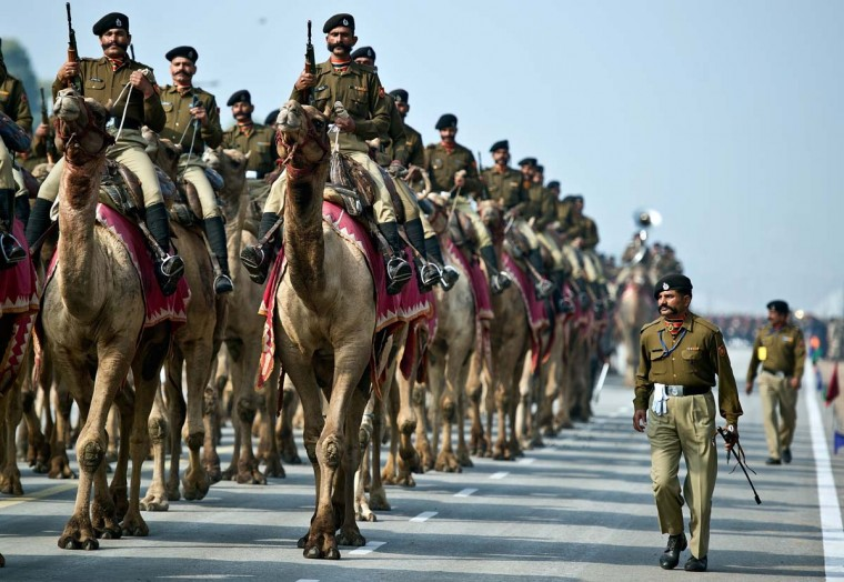 An Indian Border Security Force (BSF) camel contingent marches past Rajpath during a rehearsal for the Indian Republic Day parade in New Delhi on January 20, 2013. India will celebrate its 64th Republic Day on January 26 with a large military parade. (Prakash Singh/AFP/Getty Images)