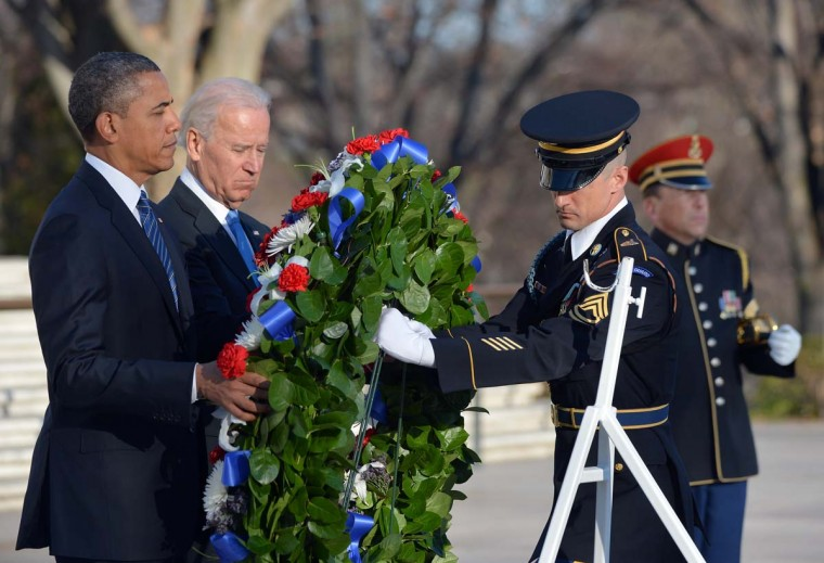 U.S. President Barack Obama and Vice President Joe Biden lay a wreath at the Tomb of the Unknowns at Arlington National Cemetery in Arlington, Virginia, on January 20, 2013. Obama will be officially sworn in for a second term in office later in the day. (Jewel Samad/AFP/Getty Images)