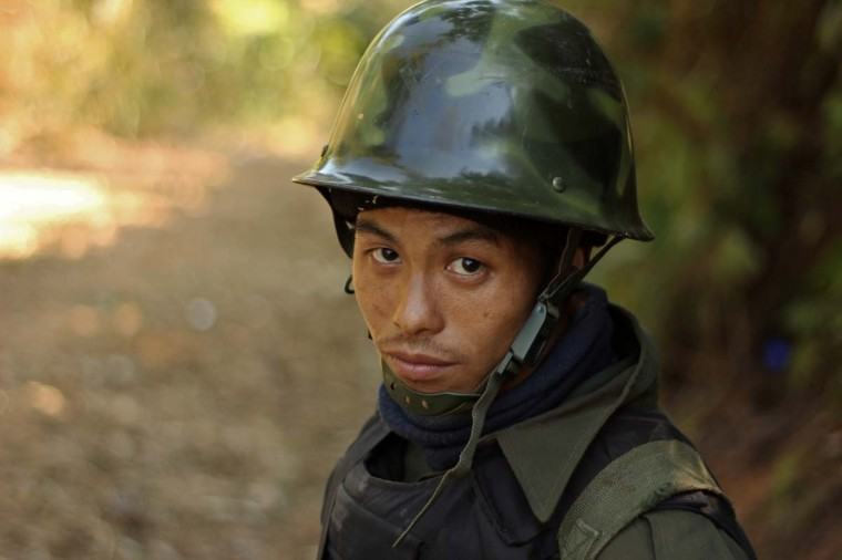A rebel Kachin Independence Army (KIA) 3rd Brigade soldier stands guard as they secure an area on Hka Ya mountain in Kachin province on January 20, 2013. Kachin ethnic minority rebels in war-torn northern Myanmar accused the military of launching a fresh attack on January 20, just days after a ceasefire pledge by the country's reformist government. (STR/AFP/Getty Images)