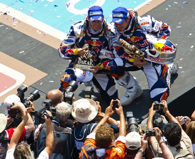 France's Cyril Despres (L) and Portugal's Ruben Faria celebrate their first and second place respectively in the 2013 Dakar Rally Moto category, in Santiago, on January 20, 2013. Stephane Peterhansel claimed a record fifth Dakar Rally drivers title, and 11th overall of his career, while French compatriot Cyril Despres captured a fifth motorcycling crown. (Martin Bernetti/AFP/Getty Images)