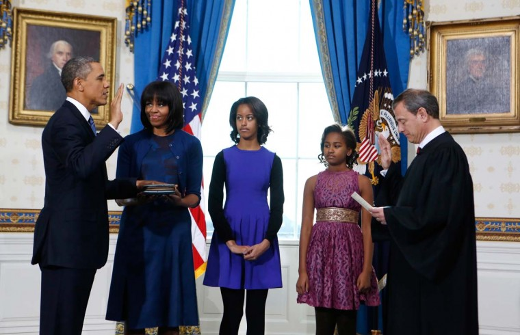U.S. President Barack Obama (L) takes the oath of office from U.S. Supreme Court Chief Justice John Roberts as first lady Michelle Obama holds the bible and their daughters Malia (C) and Sasha (2nd R) look on in the Blue Room of the White House in Washington on January 20, 2013. (Larry Downing/Reuters)