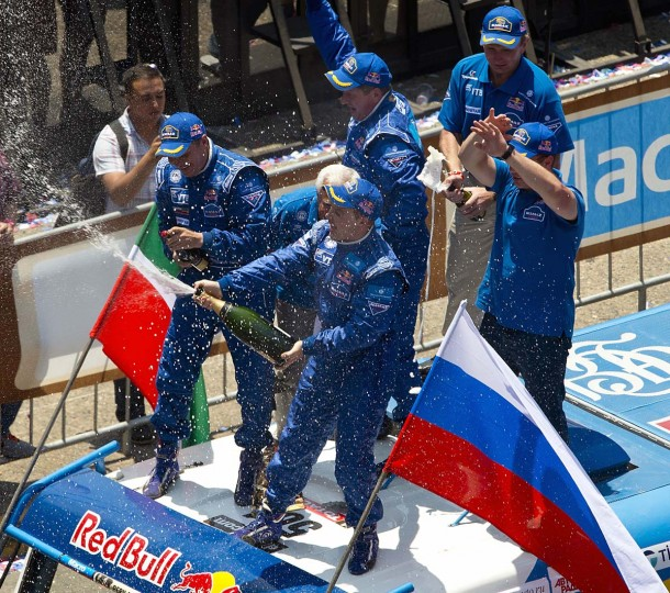 Kamaz team members Eduard Nikolaev (C) Sergey Savostin (L) and Vladimir Rybakov of Russia, celebrate their first place on the 2013 Dakar Rally Truck category, during the podium ceremony, in Santiago, Chile, on January 20, 2013. Stephane Peterhansel claimed a record fifth Dakar Rally drivers title, and 11th overall of his career, while French compatriot Cyril Despres captured a fifth motorcycling crown. (Martin Bernetti/AFP/Getty Images)