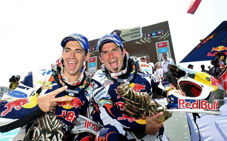 KTM's rider Cyril Despres (R) of France and KTM's rider Ruben Faria of Portugal celebrate their first and second place at the podium of the 2013 Dakar Rally in Santiago, Chile on January 20, 2013. Stephane Peterhansel claimed a record fifth Dakar Rally drivers title, and 11th overall of his career, while French compatriot Cyril Despres captured a fifth motorcycling crown. (Franck Fife/AFP/Getty Images)