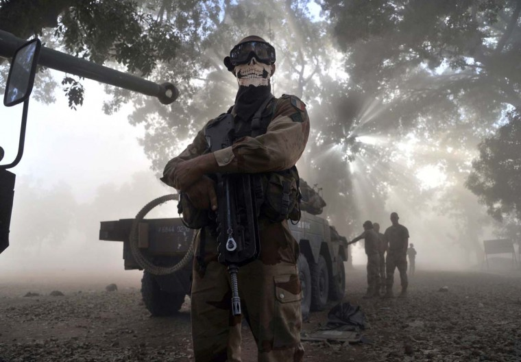 "A French soldier wearing a skeleton mask stands next to a tank in a street in Niono, on January 20, 2013. French Defence Minister Jean-Yves Le Drian said today that the goal of France's military action in Mali was to retake control of the entire country from Islamist militants who have seized the north. ""The goal is the total reconquest of Mali. We will not leave any pockets"" of resistance, Le Drian said on French television. (Issouf Sanogo/AFP/Getty Images)"