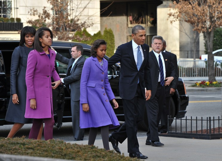 US President Barack Obama, First Lady Michelle Obama and their daughters Sasha and Malia arrive at St. John's Church hours before Obama participates in a ceremonial swearing in for a second term in office. (Nicholas KAMMNICHOLAS/Getty Images)