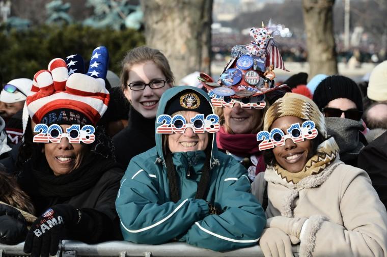 Revelers don 2013 glasses. (PAUL J. RICHARDS/Getty Images)