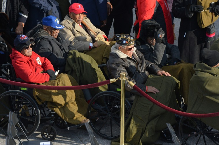 War veterans line up to watch the ceremony. (Jewel Samad/Getty Images)