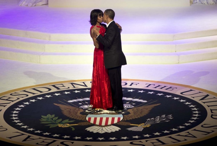 U.S. President Barack Obama and First Lady Michelle Obama kiss while dancing at the Commander and Chief Ball at the Washington Convention Center January 21, 2013 in Washington, DC. Obama and Biden attended Inauguration balls after being ceremonially sworn in for a second term leading the United States earlier today. (Brendan Smialowski/AFP/Getty Images)