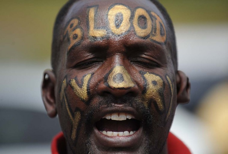 A man shouts during a protest on January 22, 2012 in Nairobi with the word's 'Blood Ivory' painted across his face. Affiliates of an amorphous activist group called Kenyans United Against Poaching took to the streets to put pressure on the government to declare the ongoing rampant poaching of rhinos and elephants, now at recently unprecendented levels, a national disaster. According to a recent report by the International Fund for Animal Welfare, IFAW, last year, 2012 stands out as the annus horriblis [Latin for 'year of horrors'] for the World's largest land mammal with statistics standing at 34 ton of poached ivory having been seized, marking the biggest ever total of confiscated ivory in a single year, in the 24 years since detailed records began, outstripping by almost 40 per cent last year's record of 24.3 tonnes. (Tony Karumba/AFP/Getty Images)