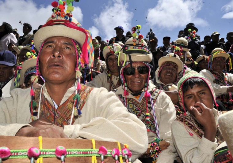 Aymara indigenous peasants attend celebrations for the third anniversary of the Plurinational State of Bolivia outside Quemado palace in La Paz, on January 22, 2013. (Aizar Raldes/AFP/Getty Images)