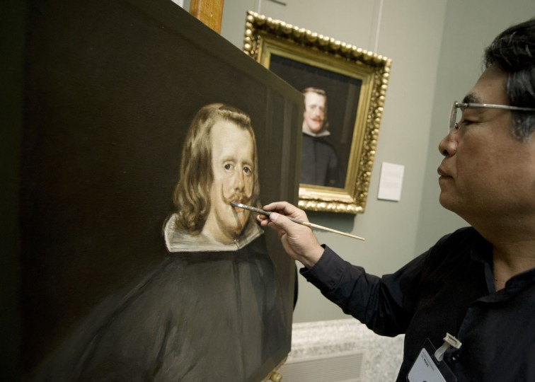 Chinese painter Yang Fei Yun works on the painting, a copy of Velazquez's paiting 'Portrait of Felipe IV' at the Prado Museum in Madrid. Chinese artists from the state academy and the China Academy of Art are due to make first-hand copies of some of the jewels of European oil painting and take them back to China to use for teaching. (Dominique Faget/AFP/Getty Images)