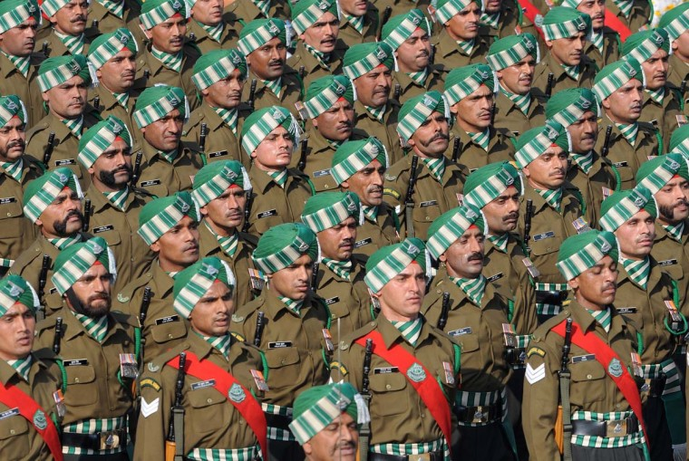 Indian soldiers march down the ceremonial boulevard Rajpath during the Republic Day parade in New Delhi on January 26, 2013. India marked its Republic Day with celebrations held under heavy security, especially in New Delhi where large areas were sealed off for an annual parade of military hardware at which Bhutan's king Jigme Khesar Namgyel Wangchuck was chief guest. (Raveen Dran/AFP/Getty Images)
