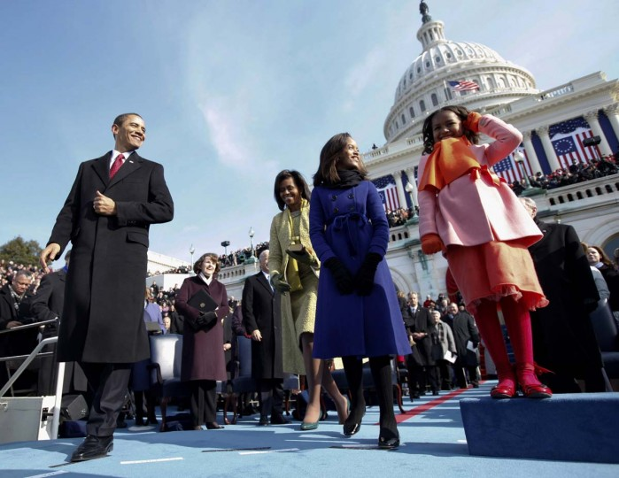 January 20, 2009 — President-elect Barack Obama, his wife Michelle and daughters Sasha, right and Malia, on the podium moments before Obama was sworn in as the 44th president at the U.S. Capitol in Washington. (Chuck Kennedy/AP File Photo)