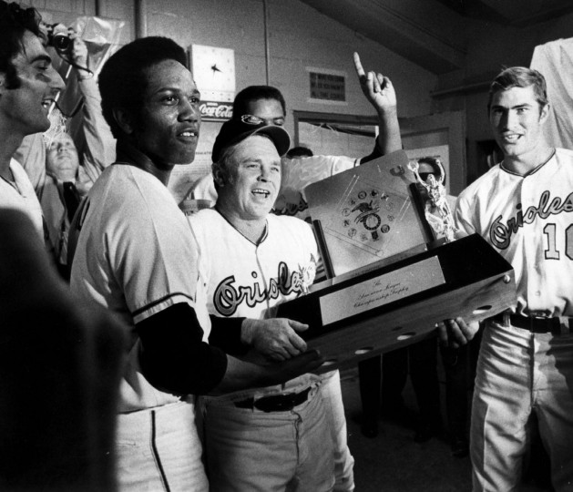 Orioles manager Earl Weaver holds the pennant trophy in the locker room after the final game of the 1970 World Series. (Lloyd Pearson/Baltimore Sun photo)