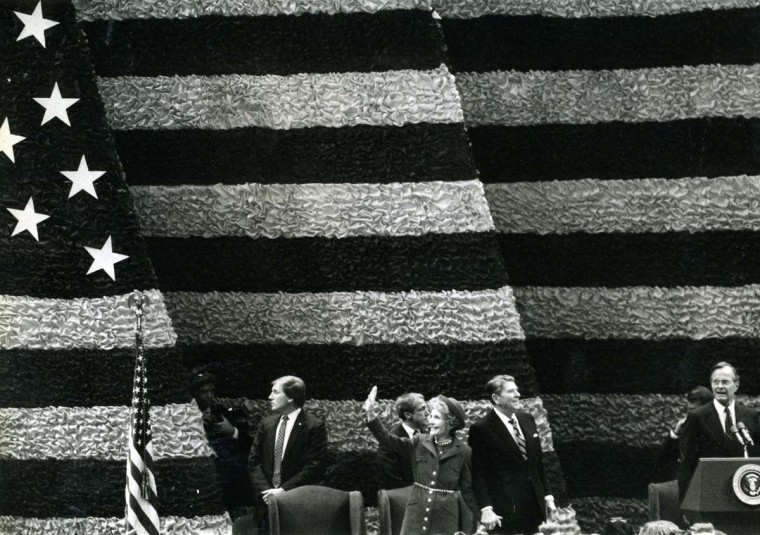January 21, 1985 —President Ronald Reagan and Mrs. Reagan wave to all the bands gathered at the Capital Centre. (Far right is V.P. George Bush). (Jed Kirschbaum/Baltimore Sun)