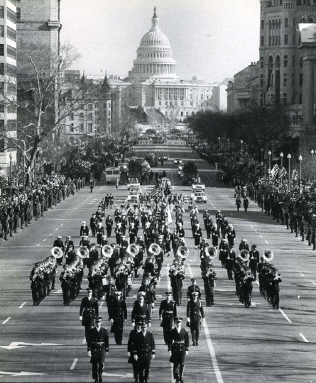 January 20, 1977 — A military band leads the Carter entourage along the inaugural parade route as sunny skies brighten the way. (J. Pat Carter/Baltimore Sun)