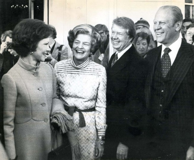 January 20, 1977 — President-elect and Mrs. Jimmy Carter are greeted at the White House Thursday by President and Mrs. Gerald Ford. The Fords invited the Carters to the White House for coffee in the Blue Room prior to Carter inauguration at noon. From left, Mrs. Carter, Mrs. Ford, Carter and Ford. (AP File Photo)