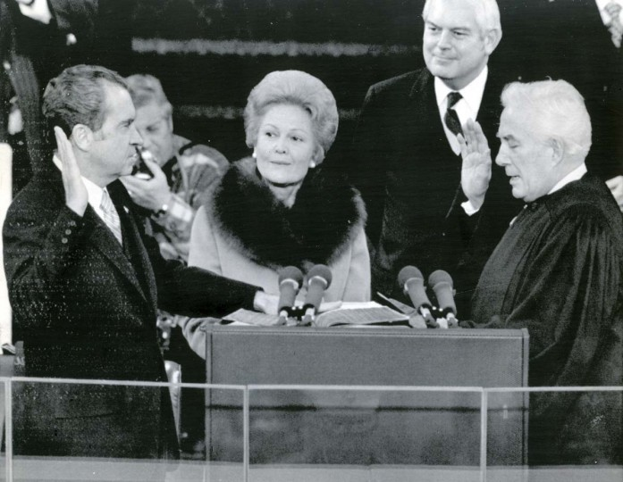 January 20, 1973 — President Richard M. Nixon takes the oath of office today from Chief Justice Warren E. Burger for the President's second term. Mrs. Nixon holds two family Bibles. (AP File Photo)