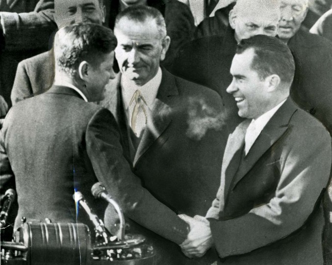 January 20, 1961 — Former Vice President Richard Nixon congratulates President John F. Kennedy in Washington today after Kennedy delivered his inaugural address. Vice President Lyndon B. Johnson stands between the two men who competed for the office of President, in the elections, won by Kennedy. (Harry Harris/File Photo)