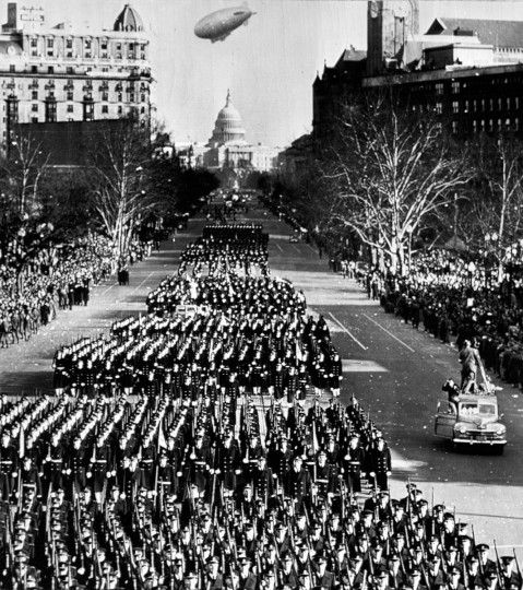 January 20, 1949 — Midshipmen of the US Naval Academy march up Pennsylvania Ave. during the inauguration parade for Harry S. Truman. (AP File Photo)