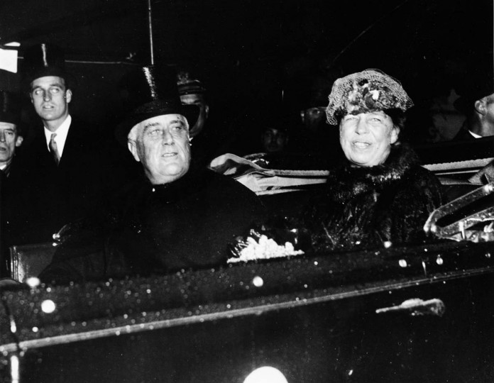 January 20, 1937 — President Franklin D. Roosevelt and Mrs. Roosevelt, thoroughly drenched by the downpour of rain, arrive at the White House in an open automobile in which they drove from the inauguration ceremony at the Capitol. President Roosevelt had been induced to ride to the ceremony in a closed car but insisted on riding in an open car so that the thousands who braved the rain might see him. (AP File Photo)