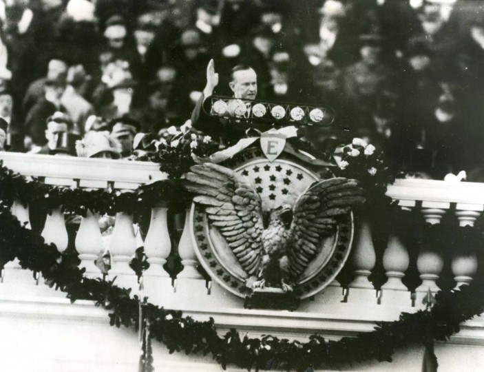 March 4, 1925 — President Calvin Coolidge delivering his Inaugural address in front of the Capitol over a battery of microphones. (AP File Photo)
