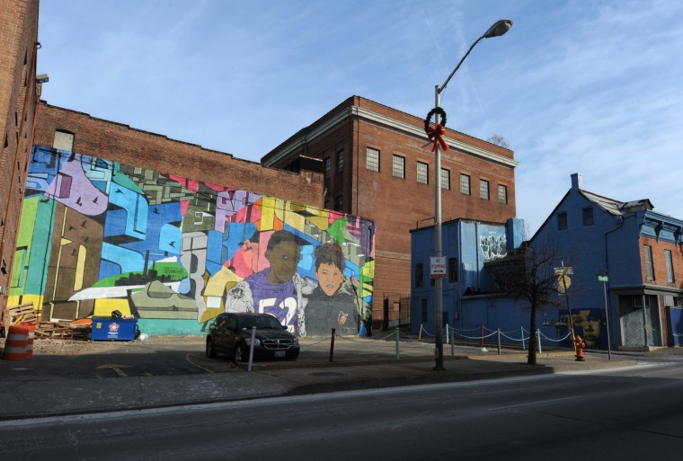 Chris Stain, originally from Baltimore and now living in NYC, & Billy Mode from Baltimore, created this mural on the south wall of the Downtown Cultural Center at 401. N. Howasrd St. (Articulate: Baltimore project) (Algerina Perna/Baltimore Sun)